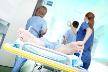 The medical team rescues critical patient in the hospital corridor  Stock Photo
