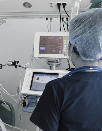 icu: Doctor woman working with electronic equipment in the ICU