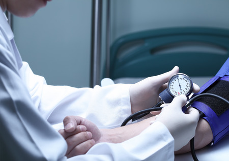 blood pressure monitor: Doctor and patient. Measurement of blood pressure in a hospital