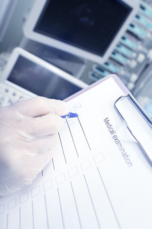 filing system: Filling out a check sheet in the hospital