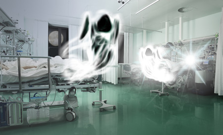 near death: Spirits flying above the critically ill patients. Сoncept of struggle between life and death Stock Photo