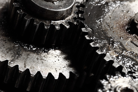 engineering tools: Oiled gears as small parts of large mechanism Stock Photo
