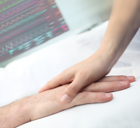 Hands touch in hospital, care and support concept