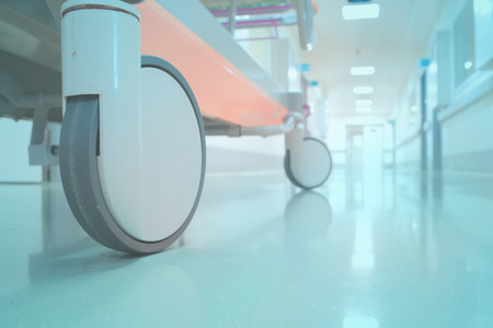 medical emergency service: Empty bed in hospital corridor perspective Stock Photo