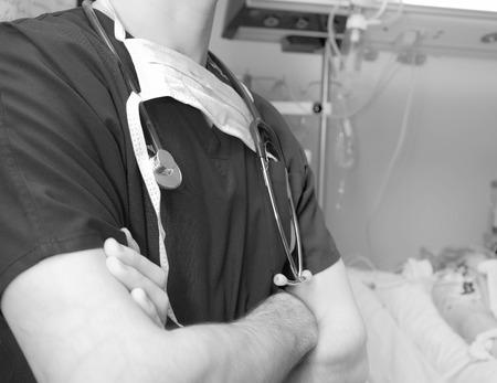 nursing unit: Doctor in intensive care ward concept in monochrome Stock Photo