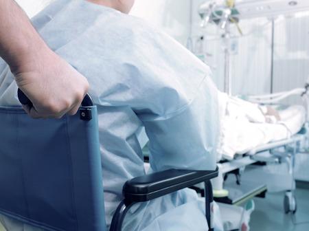 nursing unit: Patient in wheelchair in the ICU Stock Photo