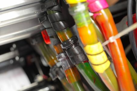 printing machine: Tubes with different colored ink in the printing machine Stock Photo