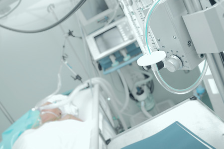 hospital patient: Patient receiving mechanical ventilation in a hospital ward Stock Photo