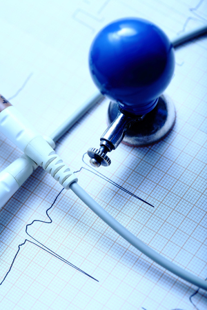 cardiological: ECG chart, electrode and the cable on the desktop of doctor Stock Photo