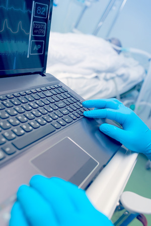 parameters: Computer technology in medical service. Doctor in the hospital working with cardiovascular parameters of the patient