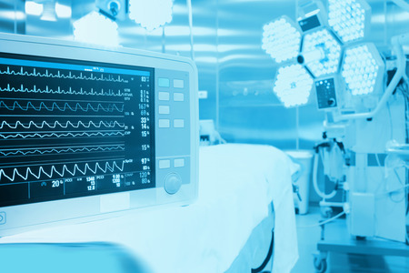 pulse trace: Monitoring of patient in surgical operating room in modern hospital Stock Photo