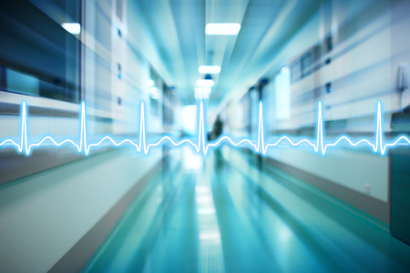 ECG line on the background of the corridor of the hospital, concept of medical emergency