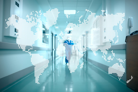 World map on the background of the hospital corridor. Concept of international cooperation in health care