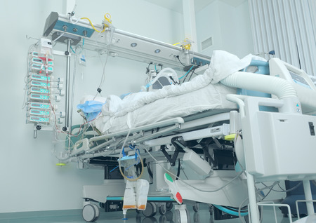 Modern bed in the intensive care with patient Reklamní fotografie