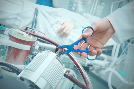 Doctor harms a patient with cutting tube in the hospital Reklamní fotografie