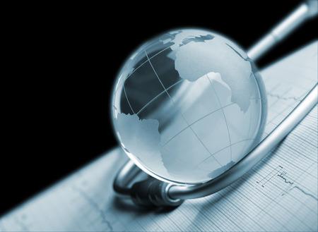 nursing association: Globe and stethoscope on ECG concept background Stock Photo