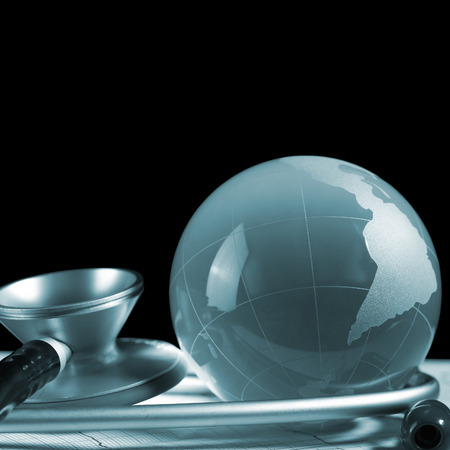nursing association: Map and stethoscope isolated on black background Stock Photo