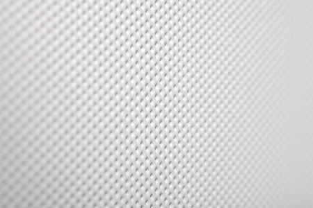 Perforated white grating industrial background