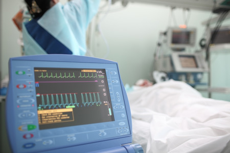 medical heart: Working nurse with the patient in ICU ward Stock Photo