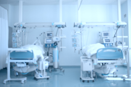 nursing unit: Hospital background. Defocused image of a hospital ward (ICU) with patients on beds