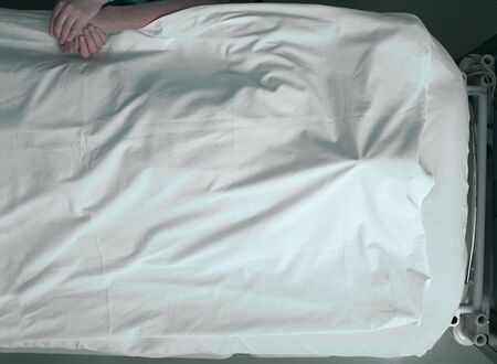 bed sheet: Dying man and a warm touch of a loving person Stock Photo