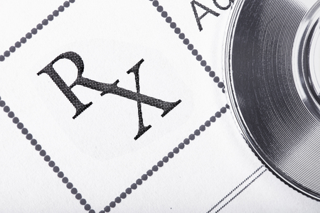 prescribe: RX prescription form and a fragment of a stethoscope Stock Photo
