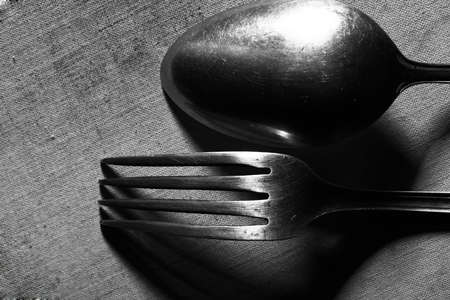 vintage cutlery: Vintage cutlery on the canvas background in monochrome