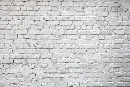 urbanized: Whitewashed brick city wall for background