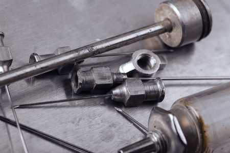 pathologist: Steel medical instruments in the old tray