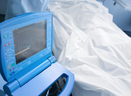 heart monitor: Patient on the bed in hospital under the monitor Stock Photo