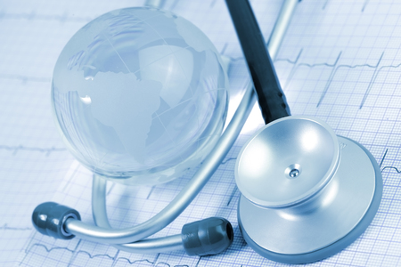 glass globe: Stethoscope and glass globe on the background of ECG paper Stock Photo