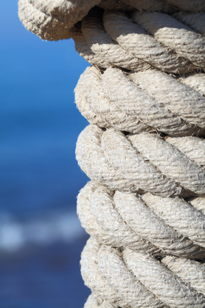 mooring: Rope knot on a jetty at the sea Stock Photo