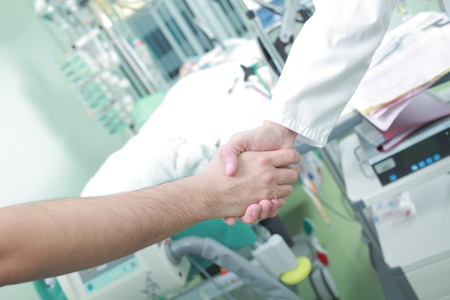 healthcare visitor: Doctor handshake as a sign of the success of treatment.