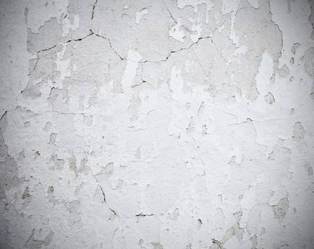 scratched: Scratched whitewashed wall, grunge background.
