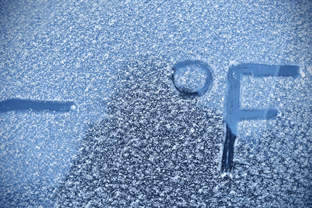 rime frost: Frost on the windshield, the concept of harsh winter for motorists Stock Photo