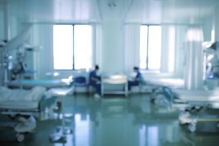 Nurses on duty in the emergency room, defocused background.