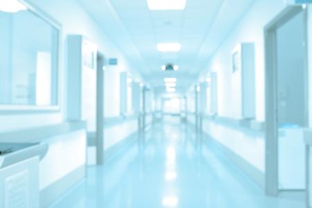 Long hospital hallway, background unfocused.