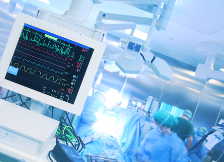medical technical equipment: Monitoring heart rate during surgery in hospital.