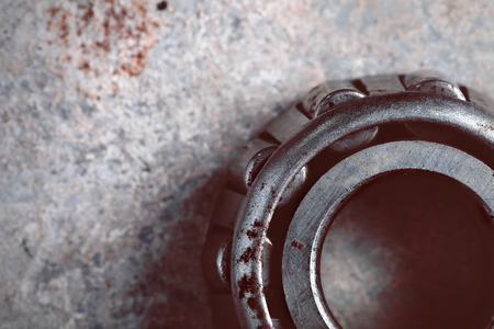 ball bearing: Rusty ball bearing on the old metal sheet. Stock Photo