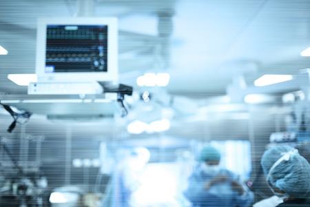 近代的な設備、多重背景と手術室の外科医の仕事。