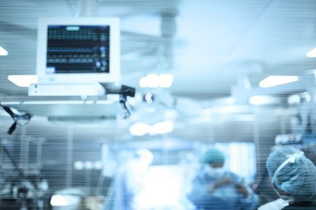 Work of surgeons in operating room with modern equipment, defocused background. Archivio Fotografico