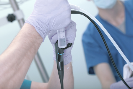 Inspection of the patient using a probe. Stock Photo