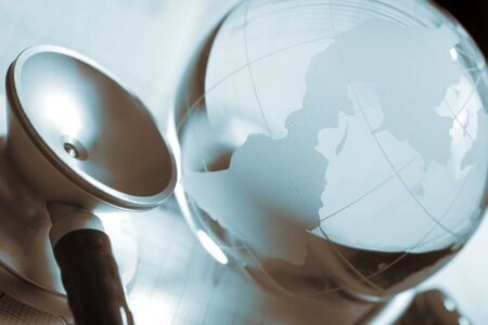 sceince: Glass globe, stethoscope and ECG symbolizes of world healthcare Stock Photo