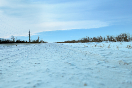 long road: Winter snow-covered long road. Stock Photo
