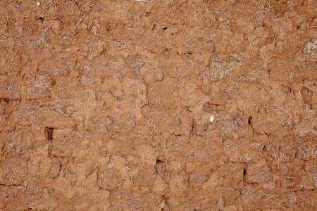 adobe wall: Textured background of old adobe wall