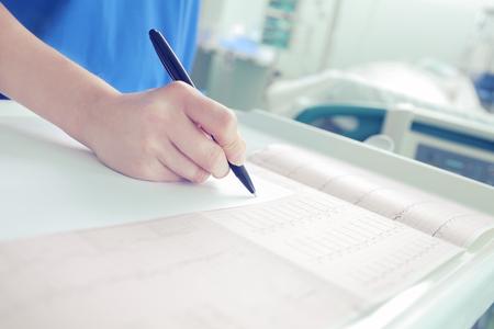 Doctor works in the patient's room. Stock fotó