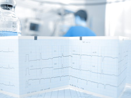 medical technical equipment: ECG and medicine on a background of the doctor in ward