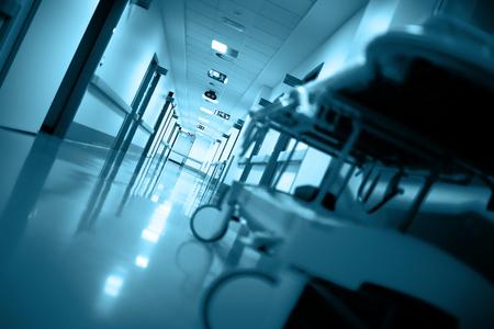 critical conditions: Empty gurney in a long corridor. Stock Photo