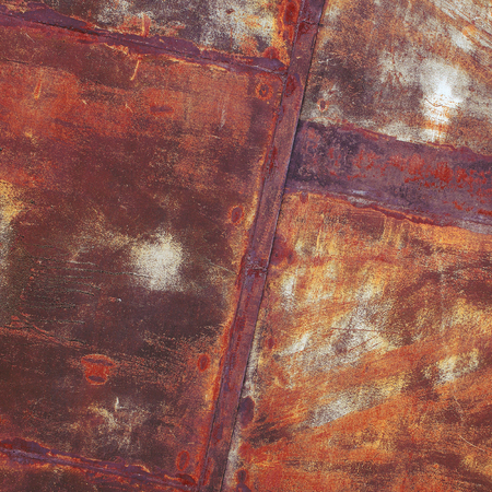 oxidate: Old rusty metal sheet with weld seam.