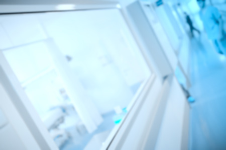 viewing: Observation window in the hospital corridor, unfocused background. Stock Photo